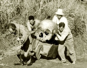 giant skull on wheel barrow